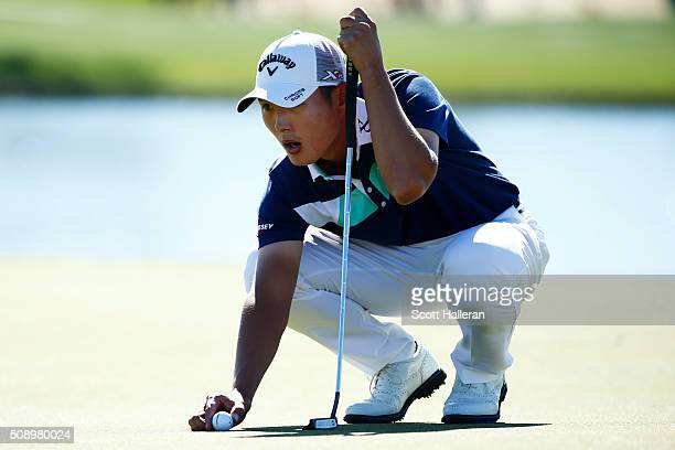 Danny Lee of New Zealand lines up a putt on the 11th hole during the final round of the Waste Management Phoenix Open at TPC Scottsdale on February 7...