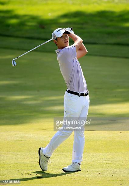 Danny Lee of New Zealand plays a shot on the third hole during the first round of the World Golf Championships Bridgestone Invitational at Firestone...