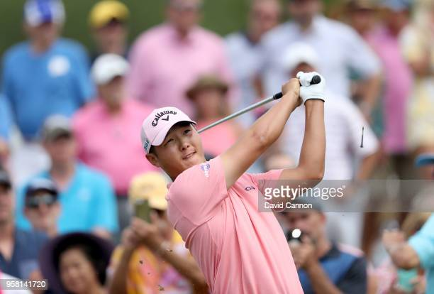 Danny Lee of New Zealand plays his tee shot on the par 3 third hole during the final round of the THE PLAYERS Championship on the Stadium Course at...