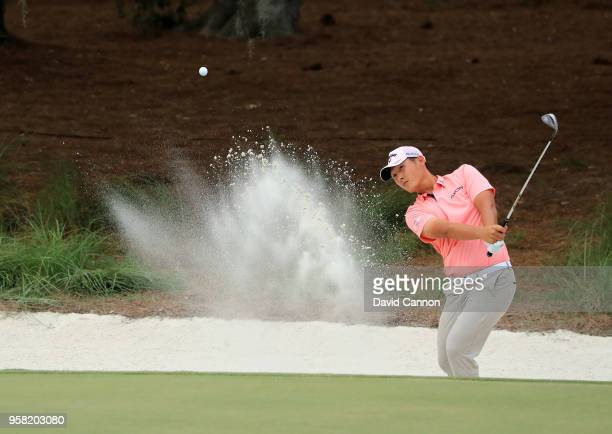 Danny Lee of New Zealand plays his third shot on the par 4 14th hole during the final round of the THE PLAYERS Championship on the Stadium Course at...