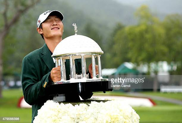 Danny Lee of New Zealand poses with the trophy after winning on the second hole of a sudden death playoff at the Greenbrier Classic held at The Old...