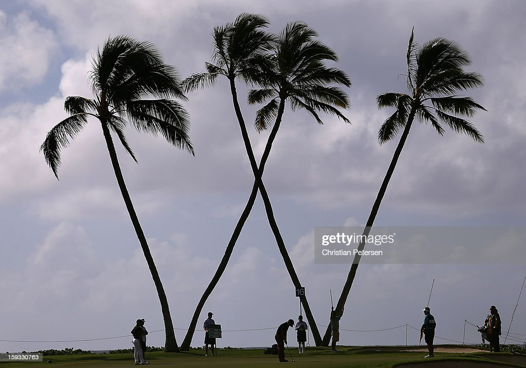 Danny Lee (C) of New Zealand putts on the 15th hole green during the second round of the Sony Open in Hawaii at Waialae Country Club on January 11, 2013 in Honolulu, Hawaii.