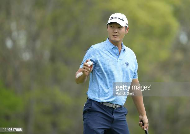 Danny Lee of New Zealand reacts to his putt on the tenth green during the first round of the 2019 PGA Championship at the Bethpage Black course on...