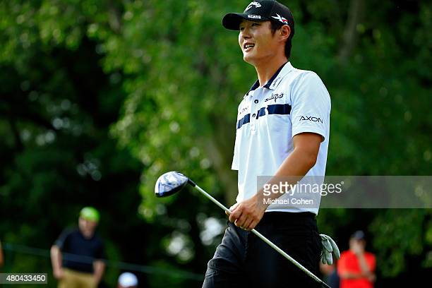 Danny Lee of New Zealand walks onto the 18th fairway after teeing off during the third round of the John Deere Classic held at TPC Deere Run on July...