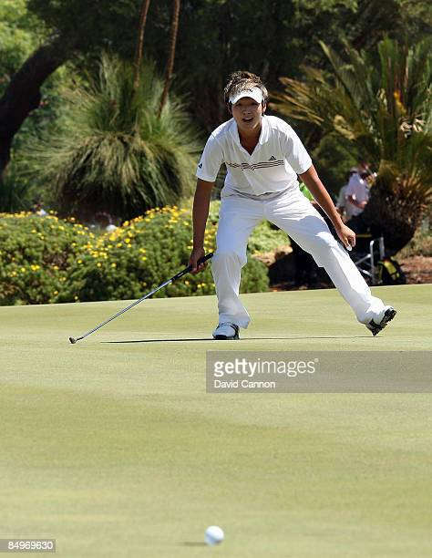 Danny Lee of New Zealand watches his eagle putt just miss at the 18th hole during the final round of the 2009 Johnnie Walker Classic tournament at...