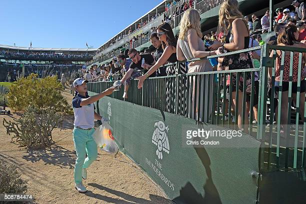 Danny Lee passes out gifts to fans on the 16th hole during the third round of the Waste Management Phoenix Open at TPC Scottsdale on February 6 2016...