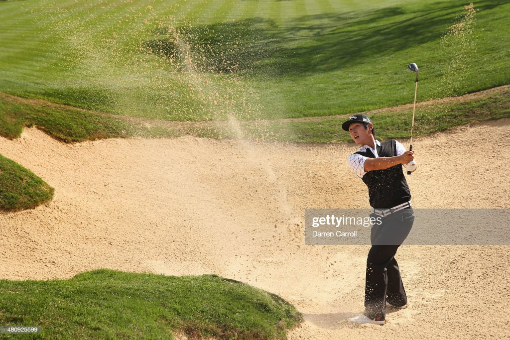 Danny Lee takes his third shot form the bunker on the 18th during Round One of the Valero Texas Open at the AT&T Oaks Course on March 27, 2014 in San Antonio, Texas.