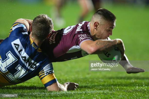 Danny Levi of the Sea Eagles scores a try during the round 10 NRL match between the Manly Sea Eagles and the Parramatta Eels at Lottoland on July 18,...