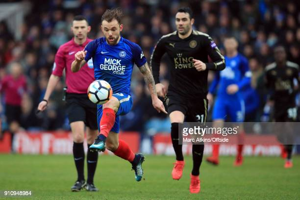 Danny Lloyd of Peterborough United in action with Vicente Iborra of Leicester City during the FA Cup 4th Round match between Peterborough United and...