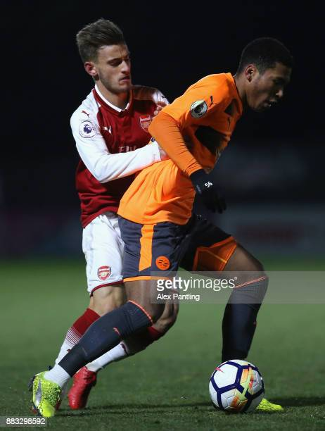 Danny Loader of Reading and Vlad Dragomir of Arsenal in action during the Premier League International Cup match between Arsenal and Reading at...