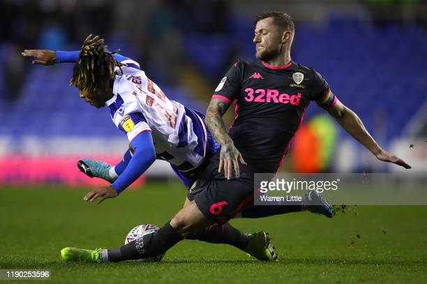 Danny Loader of Reading FC is tackled by Liam Cooper Captain of Leeds United during the Sky Bet Championship match between Reading and Leeds United...