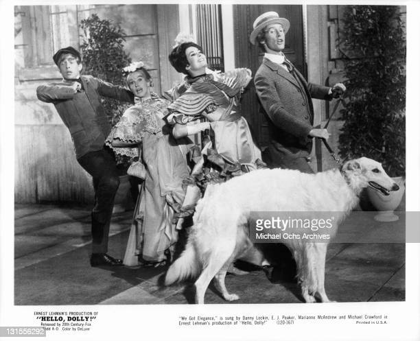 Danny Lockin, EJ Peaker, Marianne McAndrew and Michael Crawford sing in a scene from the film 'Hello Dolly!', 1969.