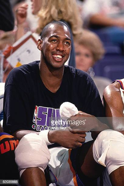 Danny Manning of the Phoenix Suns smiles from the bench during an NBA game against the Atlanta Hawks on October 30 1994 at America West Arena in...