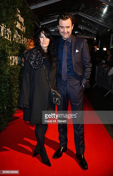 Danny Mays and Louise Burton arrive at the London Evening Standard British Film Awards at Television Centre on February 7 2016 in London England