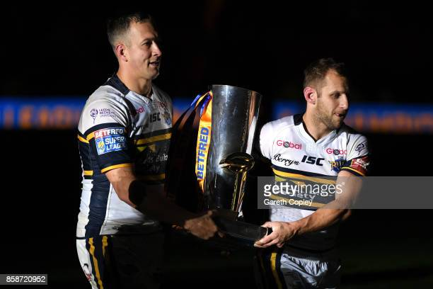Danny McGuire and Rob Burrow of Leeds Rhinos hold the trophy at the end of the Betfred Super League Grand Final match between Castleford Tigers and...