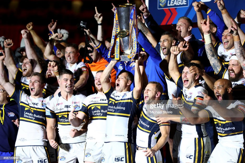 Danny McGuire and Rob Burrow of Leeds Rhinos lift the trophy with their team-mates at the end of the Betfred Super League Grand Final match between Castleford Tigers and Leeds Rhinos at Old Trafford on October 7, 2017 in Manchester, England.