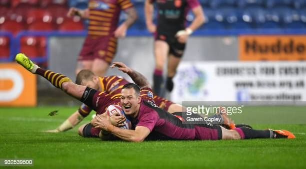 Danny McGuire of Hull KR celebrates with teammates after scoring a second half try during the Betfred Super League match between Huddersfield Giants...