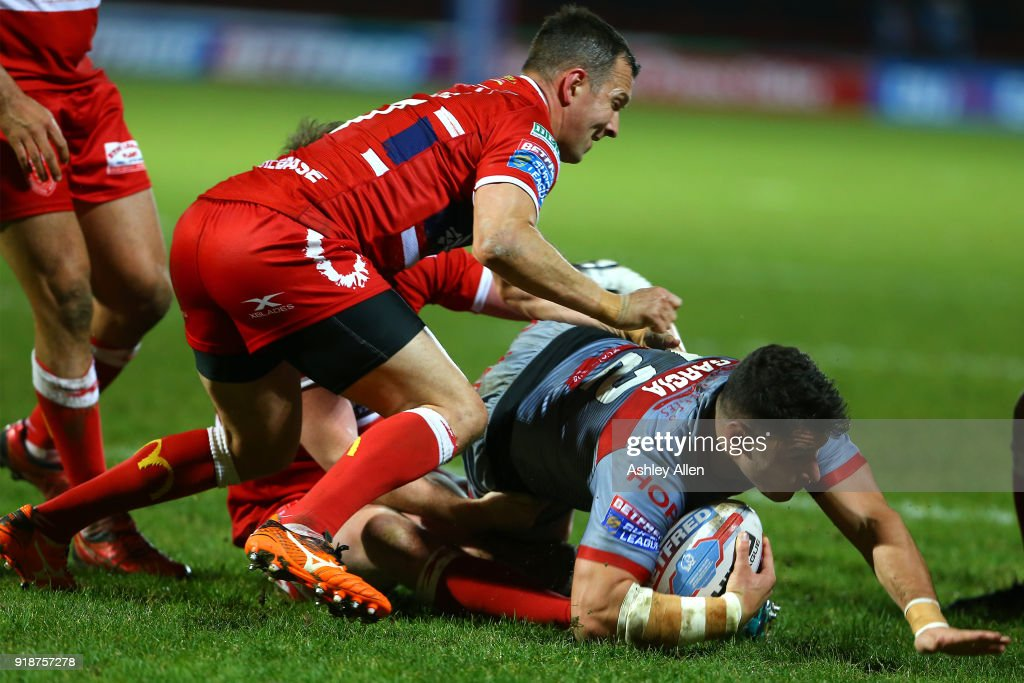 Danny McGuire (L) of Hull KR tackles Benjamin Garcia (R) of the Catalans Dragons during the BetFred Super League match between Hull KR and Catalans Dragons at KCOM Craven Park on February 15, 2018 in Hull, England.