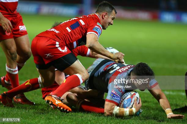 Danny McGuire of Hull KR tackles Benjamin Garcia of the Catalans Dragons during the BetFred Super League match between Hull KR and Catalans Dragons...