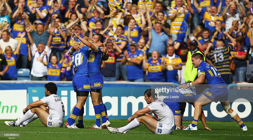 Danny McGuire (c) of Leeds celebrates his teams victory during the Carnegie Challenge Cup Semi Final match between Leeds Rhinos and St. Helens at the Galpharm Stadium on August 7, 2010 in Huddersfield, England.