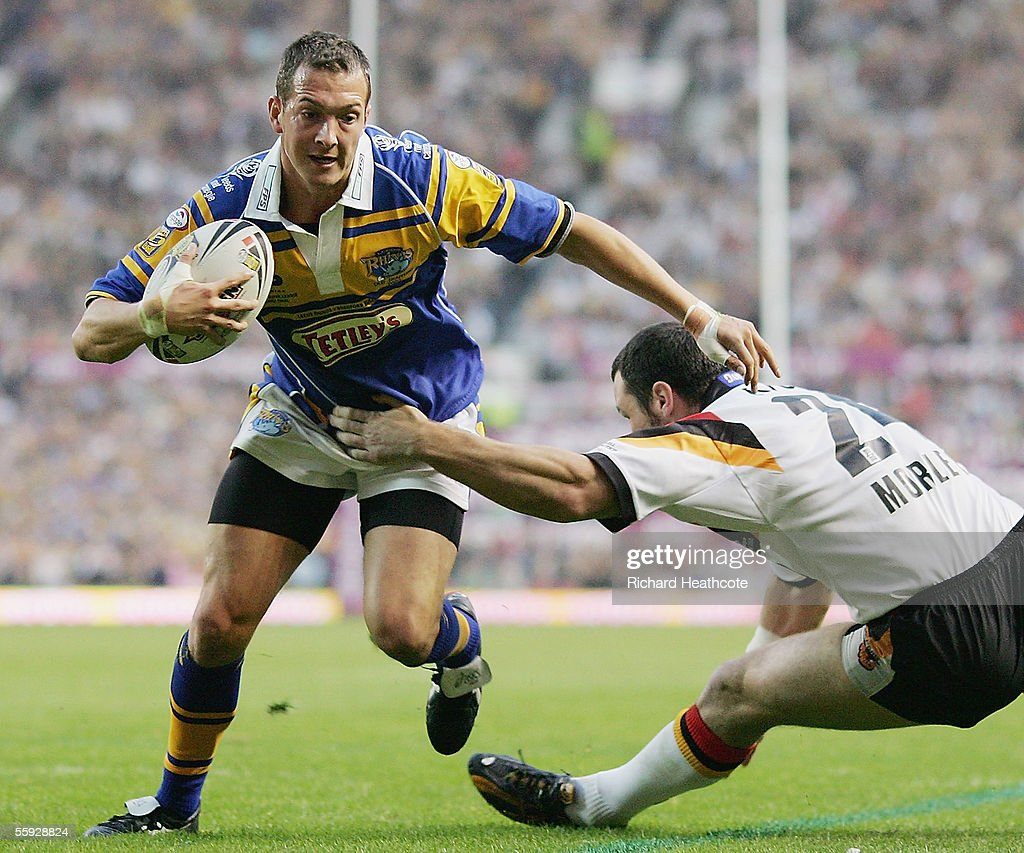 Danny McGuire of Leeds is tackled by Adrian Morley of Bradford during the Engage Super league Grand Final between Leeds Rhinos and Bradford Bulls at Old Trafford on October 15, 2005 in Manchester, England.