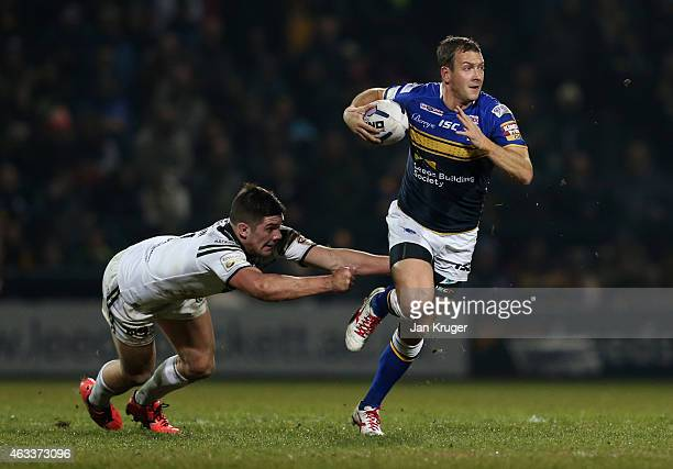 Danny McGuire of Leeds Rhinos breaks through the tackle of Chris Clarkson of Widnes Vikings during the First Utility Super League match between Leeds...