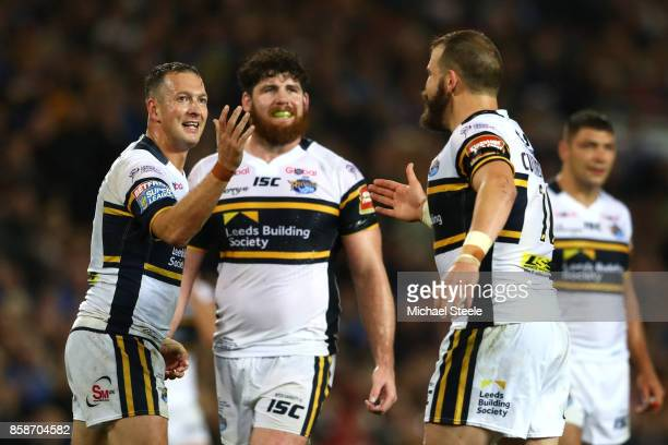 Danny McGuire of Leeds Rhinos celebrates scoring the second try with teammates Adam Cuthbertson and Mitch Garbutt during the Betfred Super League...