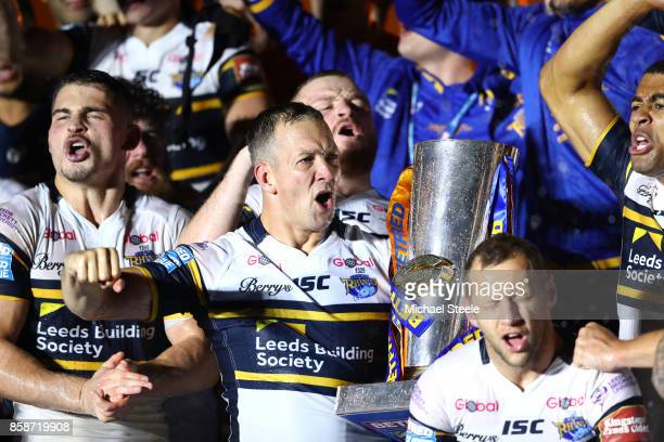 Danny McGuire of Leeds Rhinos celebrates with the trophy and his teammates at the end of the Betfred Super League Grand Final match between...