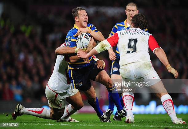 Danny McGuire of Leeds Rhinos is tackled during the Engage Super League Grand Final between Leeds Rhinos and St Helens Old Trafford on October 10,...