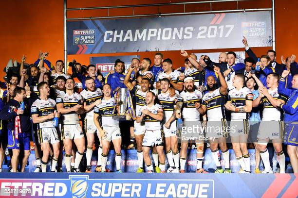 Danny McGuire of Leeds Rhinos lifts the trophy with his teammates at the end of the Betfred Super League Grand Final match between Castleford Tigers...