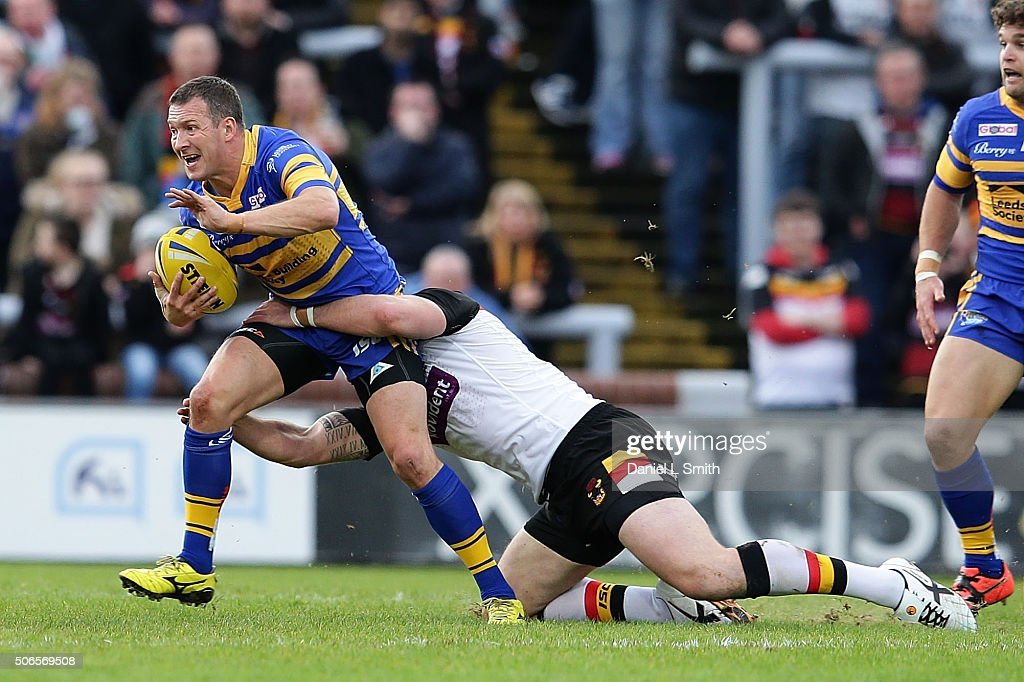 Danny McGuire (C) of Leeds Rhinos under a tackle from Adam Sidlow of Bradford Bulls during the Leeds Rhinos v Bradford Bulls friendly match at Headingley Carnegie Stadium on January 24, 2016 in Leeds, England.