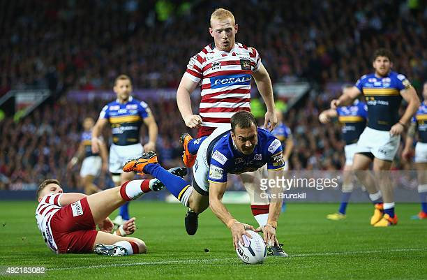 Danny McGuire of the Leeds Rhinos breaks through to score his teams first try against of the Wigan Warriors during the First Utility Super League...
