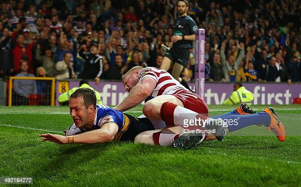 Danny McGuire of the Leeds Rhinos scores his teams third try against of the Wigan Warriors during the First Utility Super League Grand Final between...
