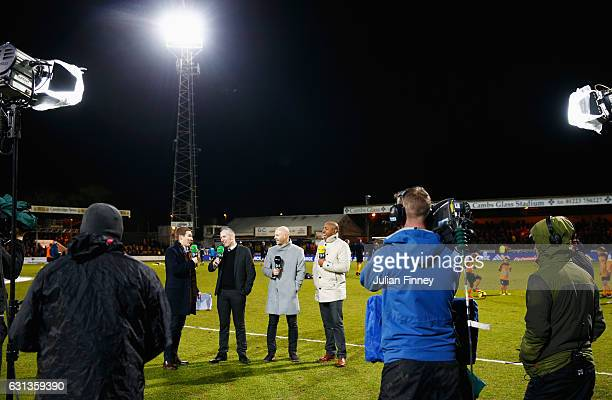 Danny Mills and Dion Dublin and the BT Sport broadcasting team prior to during the Emirates FA Cup Third Round match between Cambridge United and...