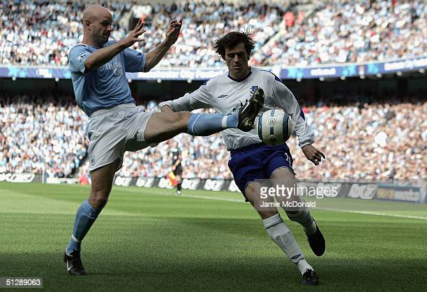 Danny Mills of Manchester City tackles Kevin Kilbane of Everton during the Barclays Premiership match at the City of Manchester Stadium on September...