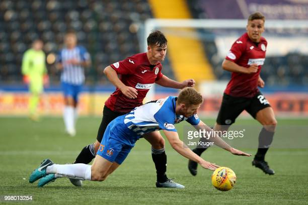 Danny Mullen of St Mirren battles with Stuart Findlay of Kilmarnock FC during the Betfred Scottish League Cup match between Kilmarnock and St Mirren...