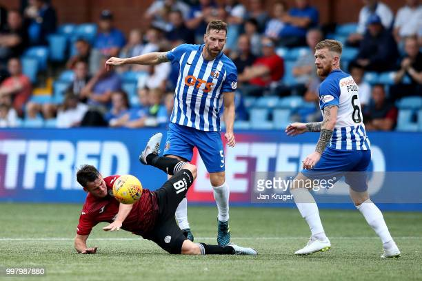 Danny Mullen of St Mirren clashes with Kirk Broadfoot of Kilmarnock FC during the Betfred Scottish League Cup match between Kilmarnock and St Mirren...