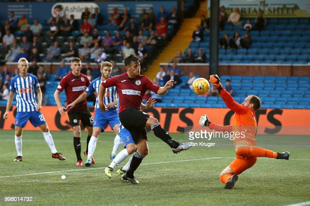 Danny Mullen of St Mirren has his shot at goal blocked by Jamie MacDonald of Kilmarnock FC during the Betfred Scottish League Cup match between...