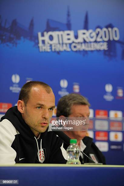 Danny Murphy answers questions while head coach Roy Hodgson looks on during the Fulham press conference ahead of the UEFA Europa League final match...