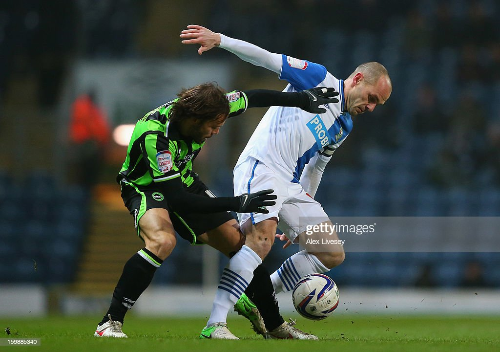 Danny Murphy of Blackburn Rovers is challenged by Inigo Calderon of Brighton & Hove Albion during the npower Championship match between Blackburn Rovers and Brighton & Hove Albion at Ewood park on January 22, 2013 in Blackburn, England.