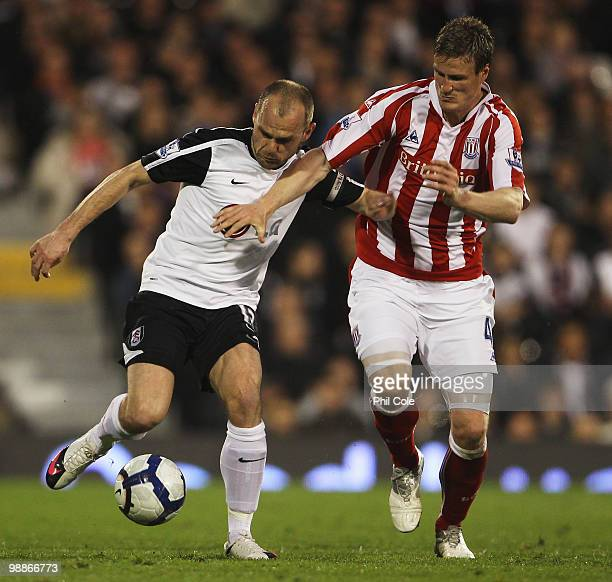 Danny Murphy of Fulham battles with Robert Huth of Stoke City during the Barclays Premier League match between Fulham and Stoke City at Craven...