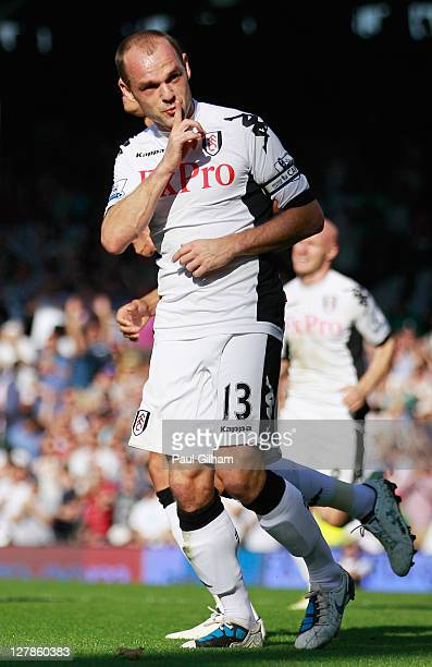 Danny Murphy of Fulham celebrates as he scores their second goal from the penalty spot during the Barclays Premier League match between Fulham and...