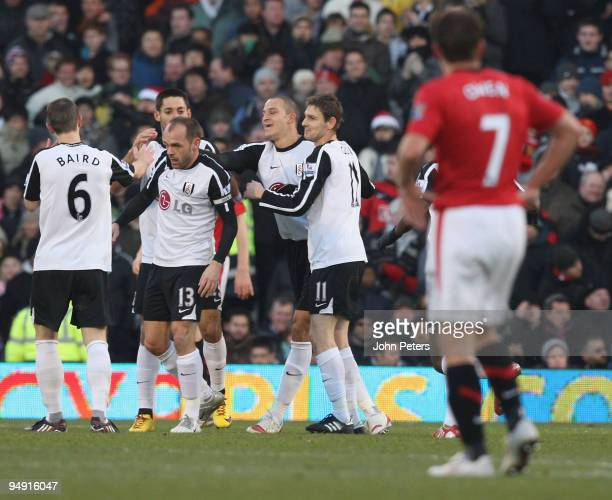 Danny Murphy of Fulham celebrates scoring their first goal during the FA Barclays Premier League match between Fulham and Manchester United at Craven...