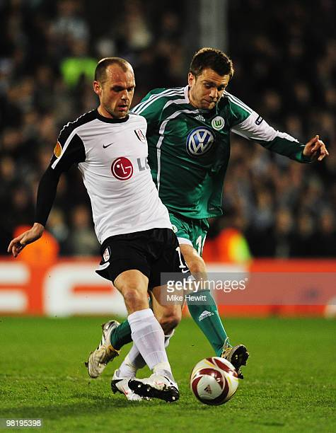 Danny Murphy of Fulham holds off Zvjezdan Misimovic of VfL Wolfsburg during the UEFA Europa League quarter final first leg match between Fulham and...