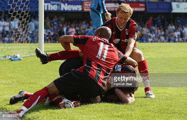 Danny Murphy of Fulham is congratulated by teammates after scoring the opening goal during the Barclays Premier League match between Portsmouth and...
