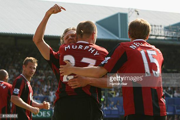 Danny Murphy of Fulham is congratulated by teammates Jimmy Bullard and Erik Nevland after scoring the opening goal during the Barclays Premier League...