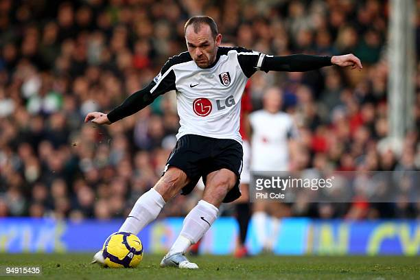 Danny Murphy of Fulham scores the opening goal during the Barclays Premier League match between Fulham and Manchester United at Craven Cottage on...