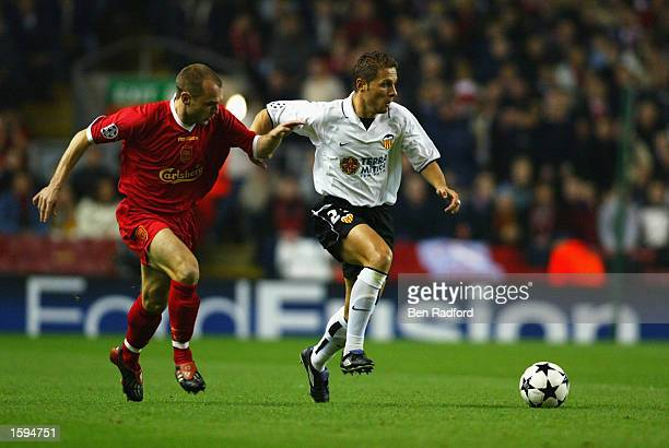 Danny Murphy of Liverpool challenges Curro Torres of Valencia for the ball during the UEFA Champions League first phase Group B match between...