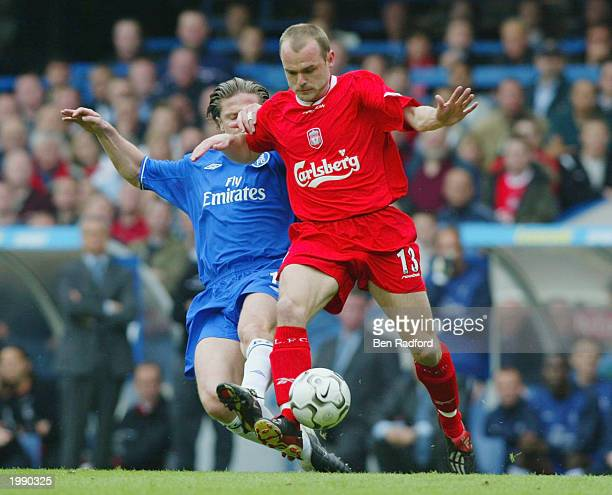 Danny Murphy of Liverpool is tackled by Emmanuel Petit of Chelsea during the FA Barclaycard Premiership match between Chelsea and Liverpool at...
