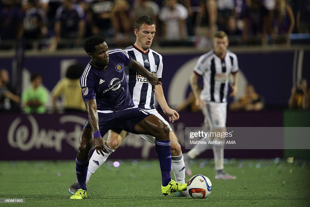 Danny Mwanga of Orlando City and Craig Gardner of West Bromwich Albion during the pre-season friendly between Orlando City and West Bromwich Albion at Orlando Citrus Bowl on July 15, 2015 in Orlando, Florida.